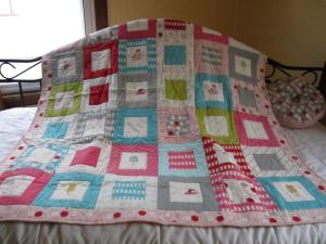 One of my first quilts (with matching sprocket pillow)